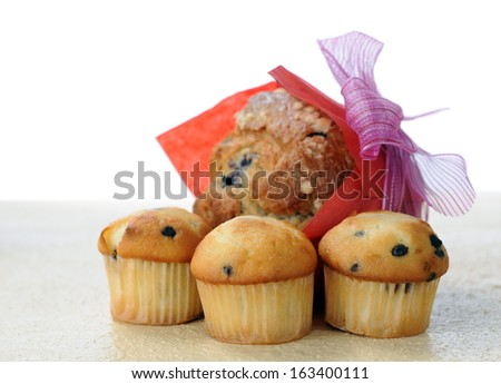 muffins with chocolate chip and blueberry inside