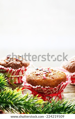 muffins with cinnamon and colorful topping on a dark wood background. tinting. selective focus on the topping