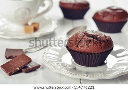 Muffins with cup of coffee and chocolate  - stock photo