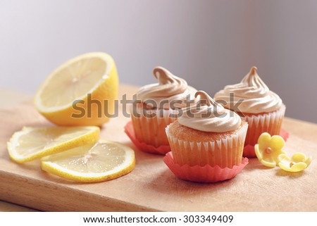 Muffins with lemon and meringue - stock photo