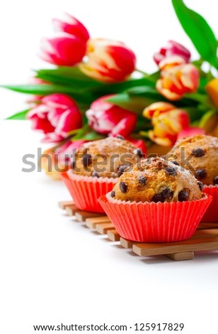 Muffins with tulips isolated on white background - stock photo