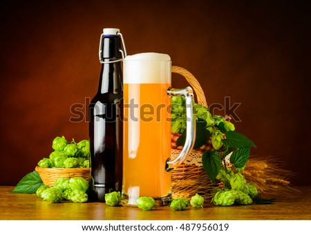 Mug and Bottle Wheat Beer with Basket of Hop flowers