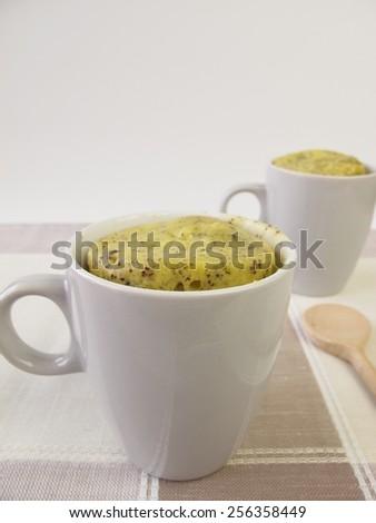 Mug Cake with poppy seeds - stock photo