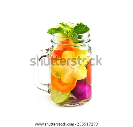 Mug delicious refreshing drink of mix fruits and herb with mint on white background, infusioned water