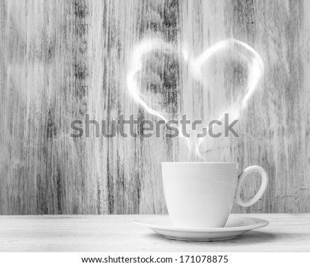 Mug for lovers. White cup with heart shaped balloon on a wooden background