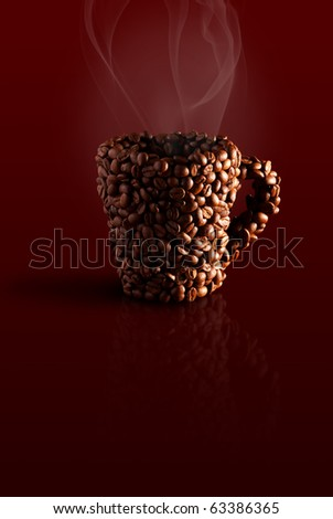 mug in the coffee beans with steam on a brown background - stock photo