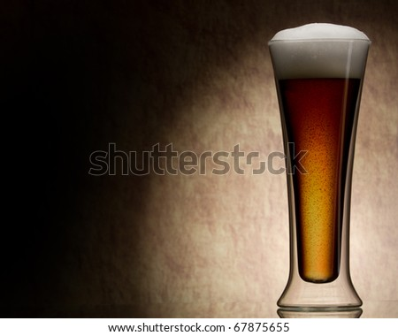 mug of beer against a stone wall