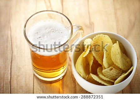mug of beer and chips - stock photo