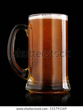 Mug of beer over black background - stock photo