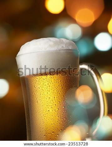 mug of beer with colorful lighting effect - stock photo