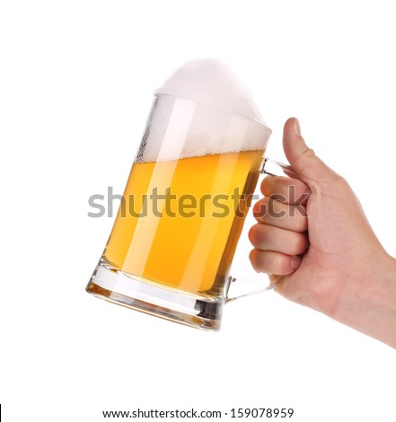 Mug of beer with foam in hand. Isolated on a white background - stock photo