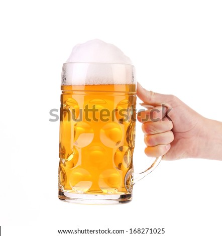 Mug of beer with foam in hand. Isolated on a white background.