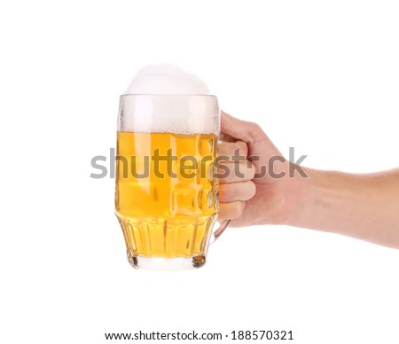 Mug of beer with foam in hand. Isolated on a white background. - stock photo