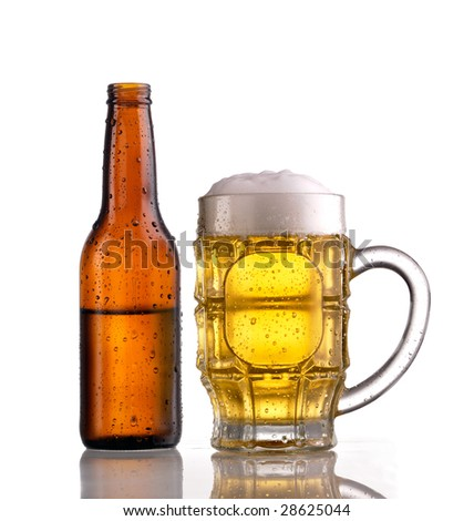 Mug of beer with froth and an open half filled brown bottle of beer, both showing condensation and droplets - stock photo