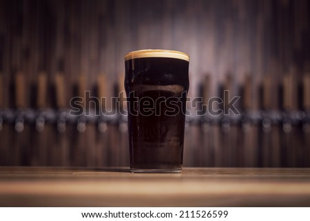 Mug of dark beer - stock photo