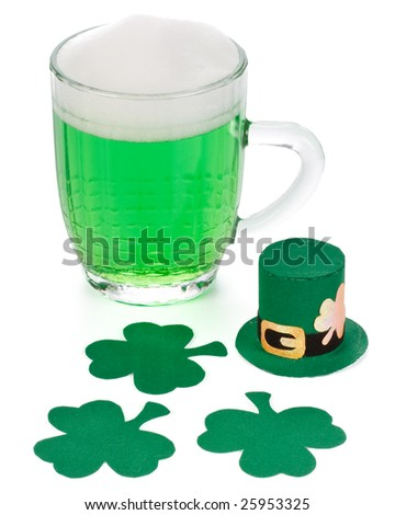 Mug of Green beer, shamrock and Leprechaun hat for St Patrick's Day - stock photo