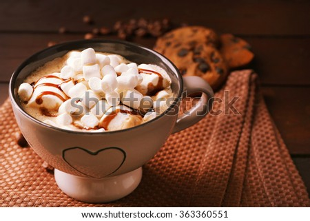 Mug of hot chocolate with marshmallows, on wooden background - stock photo
