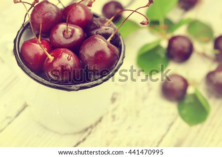 Mug of sweet fresh cherries, selective focus, toned