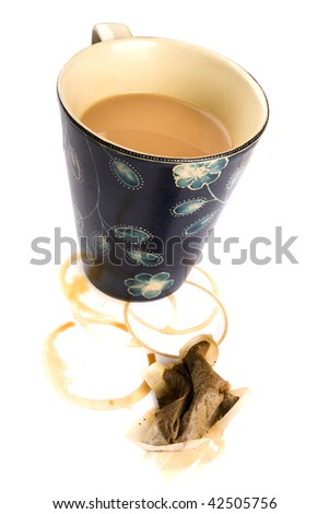 Mug of tea with a squashed teabag and stains - stock photo