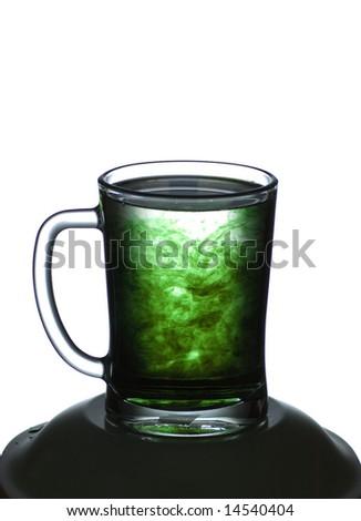 Mug with a green liquid - stock photo
