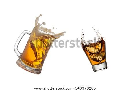 Mug with beer and glass of whiskey splashing isolated on white background. - stock photo