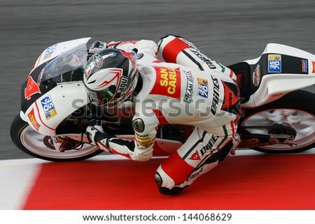 MUGELLO - ITALY, JUNE 1: Italian Honda rider Francesco Bagnaia at 2013 TIM MotoGP of Italy at Mugello circuit on June 1, 2013 - stock photo