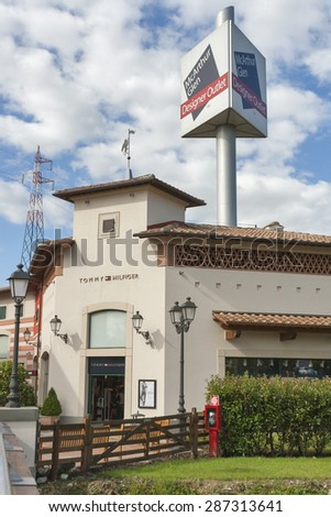 MUGELLO, ITALY - SEPTEMBER 11, 2014: Facade of Tommy Hilfiger store in McArthurGlen Designer Outlet Barberino. Tommy Hilfiger Corporation is an American clothing company incorporated in Hong Kong.