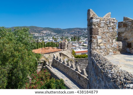 MUGLA, TURKEY - MAY 28, 2016 : Brillant landscape view from historical old Bodrum Castle with stone walls on blue sky background.