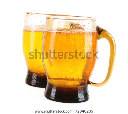 Mugs of beer isolated on white