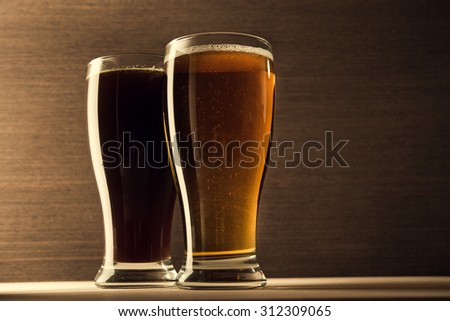 Mugs of beer on wooden table