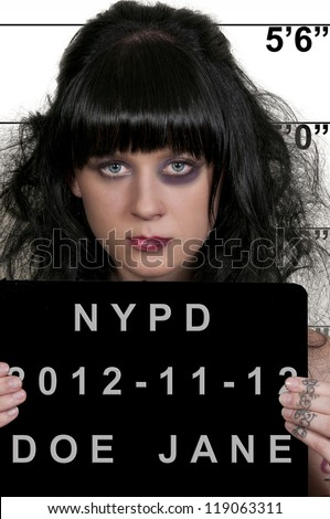 Mugshot of a beautiful young woman criminal - stock photo