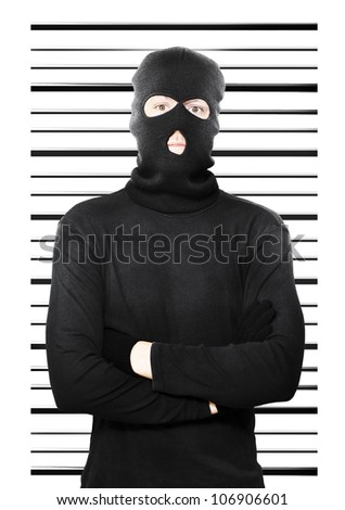 Mugshot of a busted thief caught in the act of petty larceny standing dejectedly in front of a police background as he is apprehended yet again as a repeat offender - stock photo