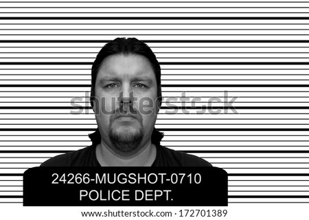 Mugshot of a man at a police department - stock photo