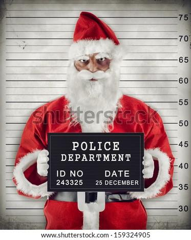 Mugshot of Santa Claus criminal under arrest. - stock photo