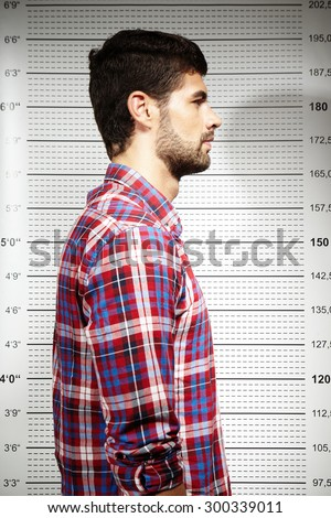 Mugshot of violent criminal - stock photo