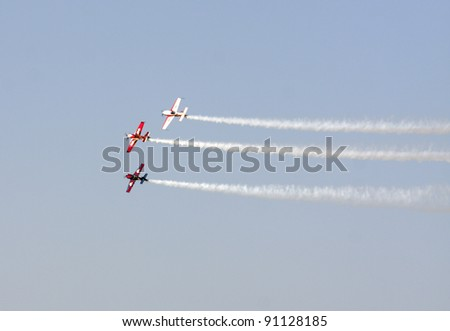 MUHARRAQ, BAHRAIN -DECEMBER 17: Stunts pilots from The Champions Aerobatic Show (TCAS) perform on December 17, 2011 on the occasion of Bahrain 40th National Day at Busaiteen beach in Muharraq, Bahrain