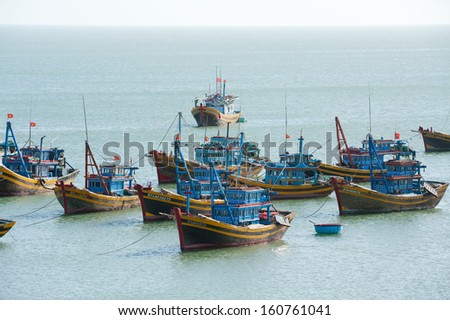 MUI NE, VIETNAM - FEBRUARY 24: Mui Ne is a very popular tourist attraction in Vietnam. A lot of local fishing boats have a day rest till the night, February 24, 2013 in Mui Ne, Vietnam.