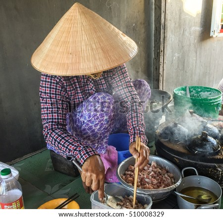 Mui Ne, Vietnam - Mar 19, 2016. A woman cooking street foods in Mui Ne township, Phan Thiet, Vietnam.