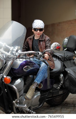 MUKACHEVO, UKRAINE - MAY 1:  An unidentified seven-year-old boy poses on a motorcycle at International bikers in Transcarpathia event on May 1, 2011 in Mukachevo, Ukraine