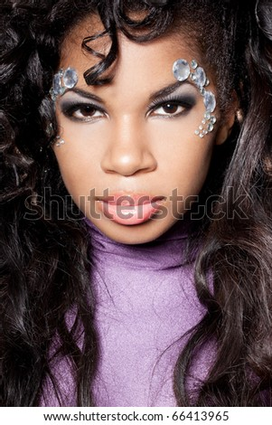 mulatto girl with crystals on the face