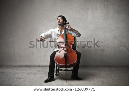 Mulatto man playing a cello - stock photo