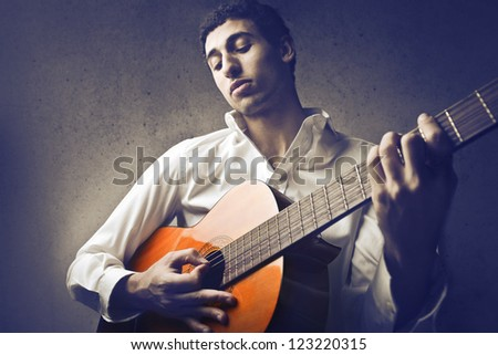 Mulatto man playing a guitar