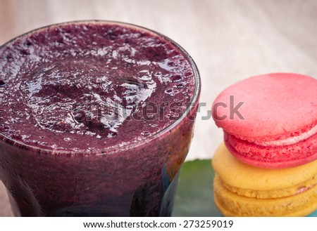 Mulberry smoothie in a glass on wood table with fresh berries. - stock photo