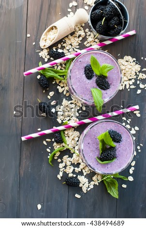Mulberry smothie with homemade granola and mint on white background - stock photo
