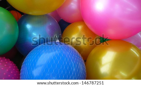 Mulitcoloured plastic balls in a ball pond - stock photo