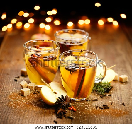 Mulled  cider with added spices and citrus. A delicious and warming hot drink perfect for autumn and winter evenings - stock photo
