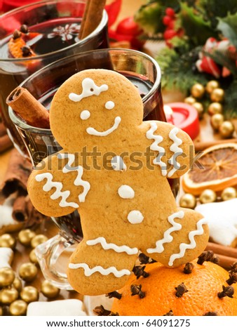 Mulled wine and gingerbread cookie. Shallow dof. - stock photo