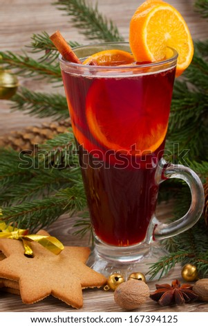 mulled wine and gingerbread cookies  on wooden table