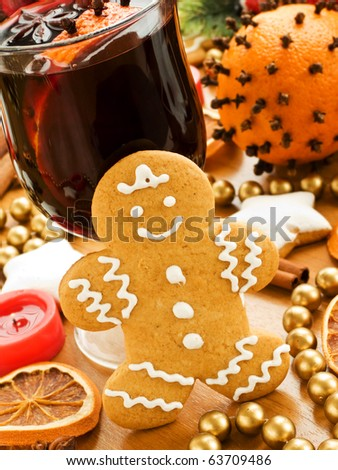 Mulled wine and gingerbread cookies. Shallow dof. - stock photo