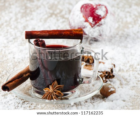 mulled wine and red apple   on a wooden table - stock photo